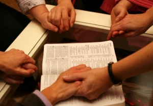 praying-hands-over-bible-small41.jpg
